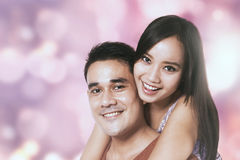 Guy and his girlfriend with bokeh background Royalty Free Stock Photos