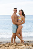 Guy and his girlfriend  on sand beach Royalty Free Stock Photography