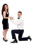 Guy on his knees proposing girl to marry royalty free stock photo