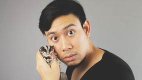 A guy with his pet. An asian man with black t-shirt royalty free stock photos
