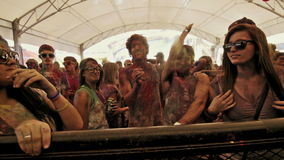 A guy hits a ball in slow motion at holi colour festival in slow motion stock footage