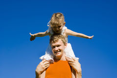 A guy holding a baby on his shoulders Stock Photo