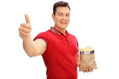 Guy holding a bag of potato chips Stock Photo