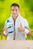 A guy holding big bottle of water Royalty Free Stock Image