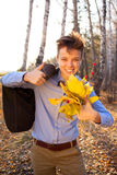 Guy holding bouquet of autumn leaves Stock Photos
