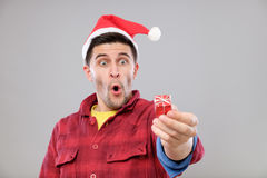 Guy holding a Christmas gift Stock Images