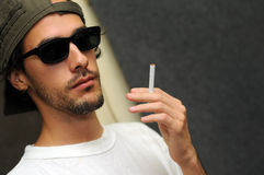 Guy holding cigarette Royalty Free Stock Image