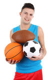 Guy holding different sports balls Stock Photos