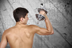 Guy holding dumbbell Royalty Free Stock Photos