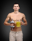 Guy holding dumbbell and juice Royalty Free Stock Images