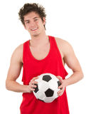 Guy holding a football Royalty Free Stock Image