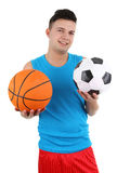 Guy holding a football and basketball Royalty Free Stock Image