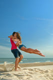 The guy holding the girlfriend. On his back royalty free stock image