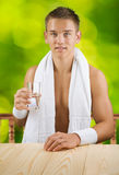 A guy holding glass of water Royalty Free Stock Photos