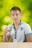 A guy holding glass of water Stock Photos