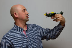 Guy holding a green aircraft Stock Images