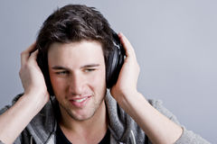 Guy holding headphones Stock Photo