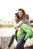 Guy is holding his girlfriend around the city Stock Image