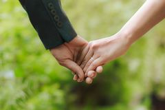 Guy holding his girlfriend`s hand stock image