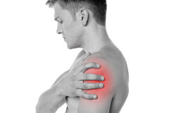Guy holding his shoulder in pain. Young man having shoulder joint pain Stock Photo