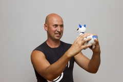 The guy is holding a mechanical dog Stock Photography