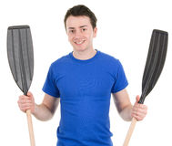 Guy holding oars Stock Images