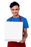 Guy holding an open pizza box Stock Photo