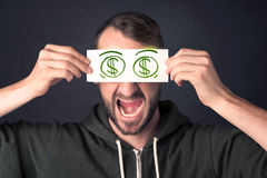 Guy holding a paper with hand drawn dollar sign Royalty Free Stock Photo