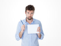 Guy holding a pen up in his hand Royalty Free Stock Photo