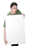 Guy holding sign. A man holding a large blank white sign ready for message Stock Image