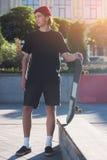 Guy holding skateboard. Stock Photo