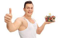 Guy holding a small shopping basket and gesturing Stock Photography