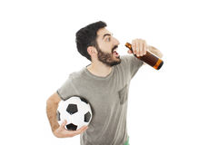 Guy holding a soccer ball, drinks beer Stock Photos