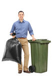Guy holding a trash bag Royalty Free Stock Images