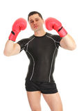 A guy holding up gloves Royalty Free Stock Photo