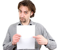 Guy holding a white blank sign Royalty Free Stock Photo