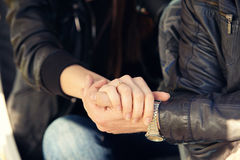 Guy holds the girl's hand Royalty Free Stock Photos