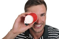 Guy holds a paper glass in a hand Stock Image