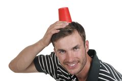 Guy holds a paper glass in a head Stock Photos