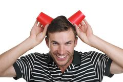 Guy holds a paper glass in a head Royalty Free Stock Photography