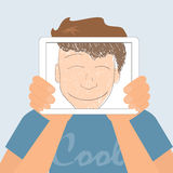 Guy holds tablet pc displaying fun smiling drawing Royalty Free Stock Image