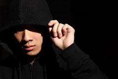 Guy in a hood Stock Images