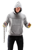 Guy with hood over his head holding a chains Royalty Free Stock Photo