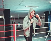 The guy in the hoodie. Boxing without gloves in the ring stock photos