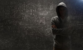 Guy in hoody. Mixed media. Criminal man wearing hoody against dark background. Mixed media Royalty Free Stock Photography