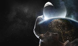 Guy in hoody. Mixed media. Criminal men wearing hoody against dark background. Mixed media. Elements of this image are furnished by NASA Stock Image