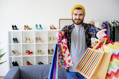 Guy hopping in a mall. A portrait of a guy shopping in a mall Royalty Free Stock Photo
