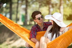 Guy hugging girl in hammock Stock Photography