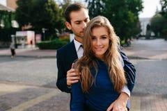 Guy hugging his girlfriend Stock Image