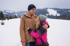 A guy hugs a girl against a backdrop of a mountain landscape in Stock Images